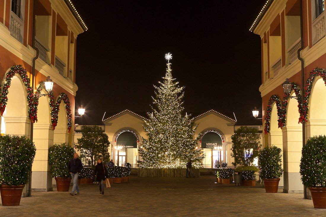 Beautifully lit large fresh Christmas tree with warm-white LEDs