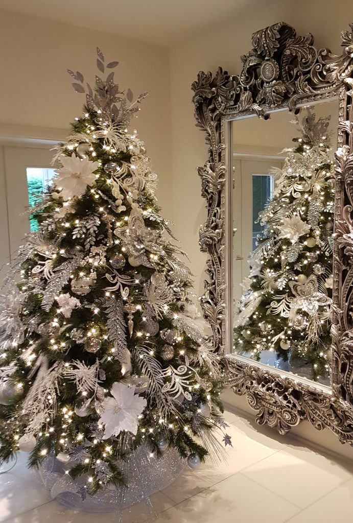 Silver Christmas Tree Near Mirror The Christmas Decorators