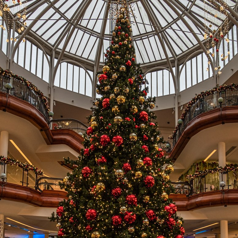 Commercial artificial Christmas tree with red and gold baubles