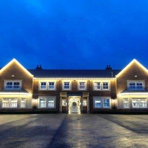 Residential roofline Christmas lighting