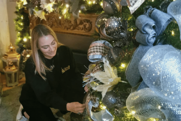 Lady decorating a Christmas tree